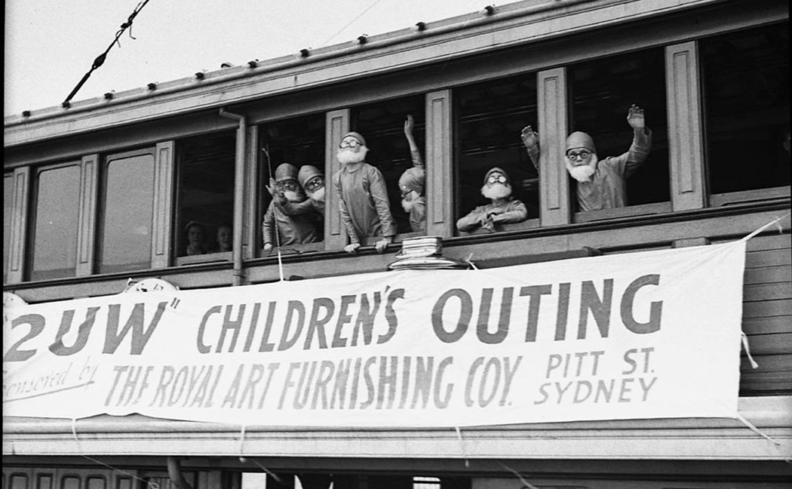 Gnomes looking out window of Kuttabul Ferry, during 2UW Harbour Cruise, 1937